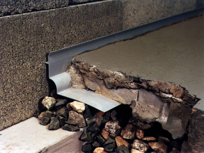 custom designed basement drain system for thin basement floors in